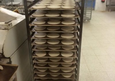 uncooked-white-roll-muffins-rack